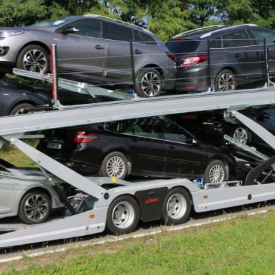 Lohr car-carrier on the road, vehicles from Eurolohr 200 range, loaded with 9 family cars.