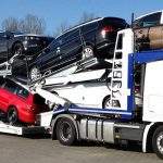 3 axles Lohr car-carrier from the range Eurolohr 300, loaded with 9 family cars.