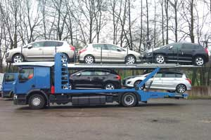 A car-carrier Lohr of the Solo Range, transporter without trailer, loaded with 5 mixed cars.