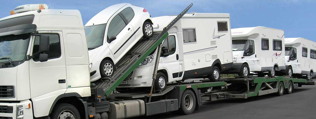 A loading of 3 camping cars and a city car on a Car Carrier Lohr: Tale.
