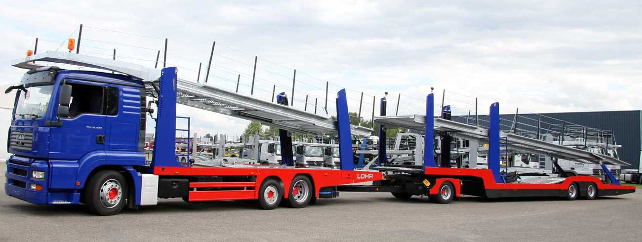 A car-carrier Lohr TrSp 25.25 in a parking of car-carriers.