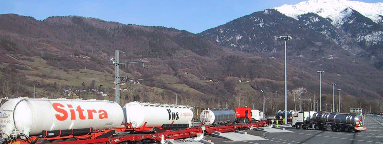 A lohr Railway System terminal with a train in loading, in the mountains of the Alpes.
