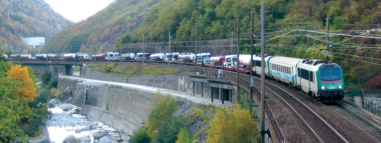Lohr UIC wagons train moving in a valley.