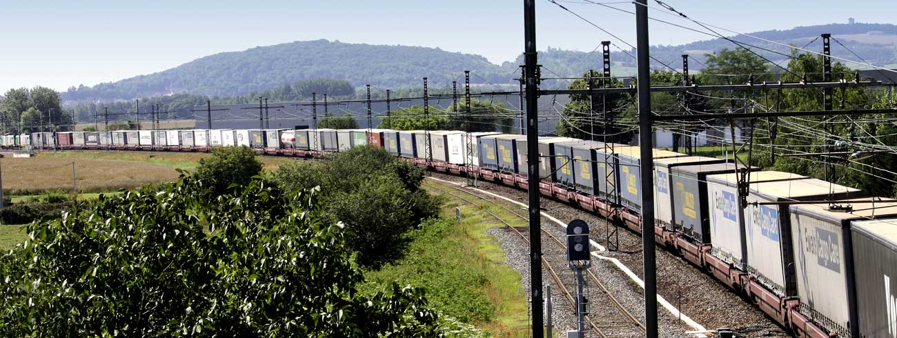 A long train of Lohr UIC wagon moving on the railway.