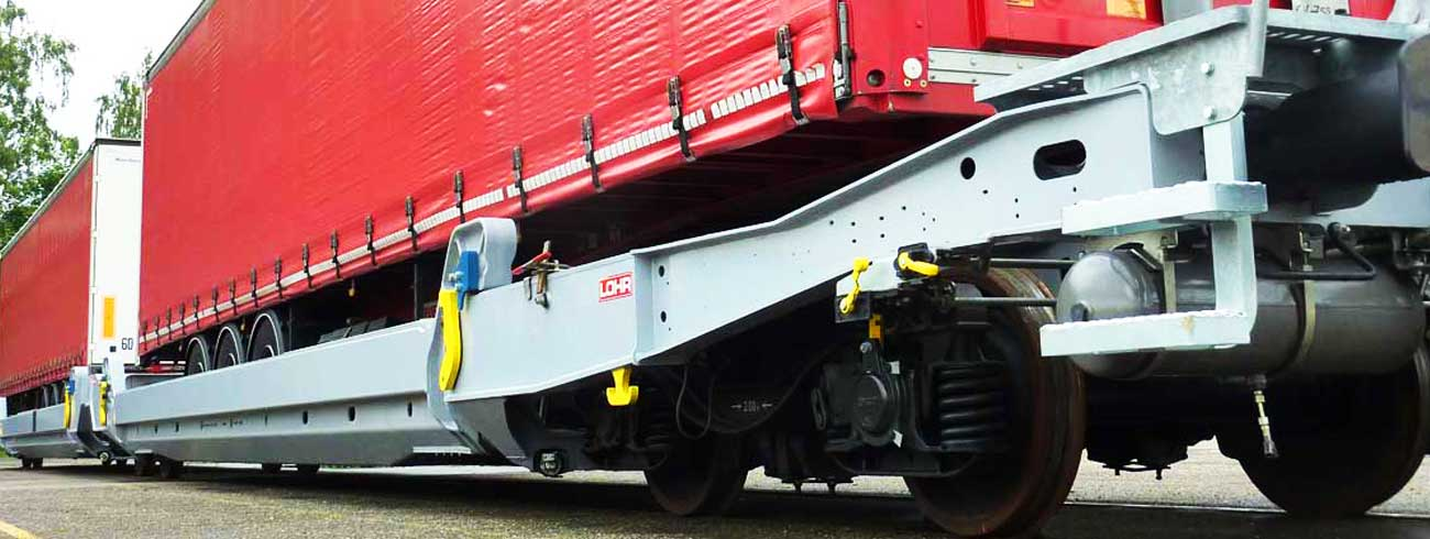 Closeup of Lohr UIC wagon with truck trailer loaded on it.