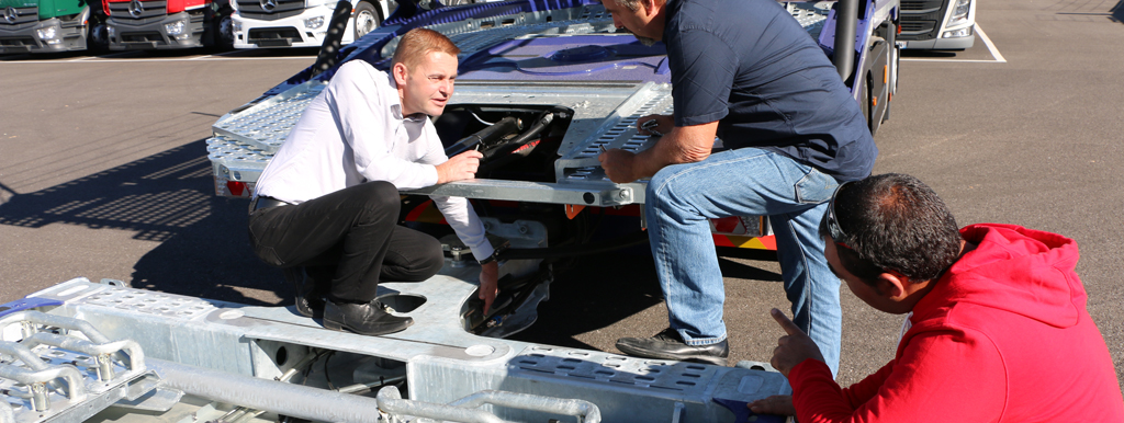 Lohr staff who teaching car-carrier drivers how to check-up their car-carriers.
