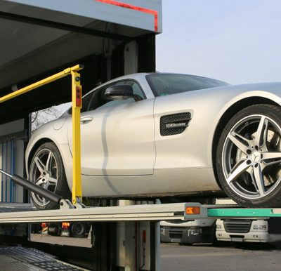 A luxurious car in loading position on a Confidential SHR.
