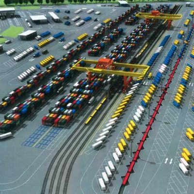 Aerial view of a full terminal Lohr Railway System, with a lot of trailers around loading stations. 3D view.