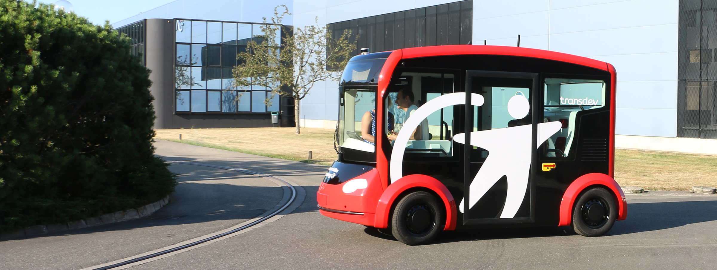 Electric and autonomous shuttle i-Cristal by Lohr moving in the industrial plant of Duppigheim, Alsace, France.